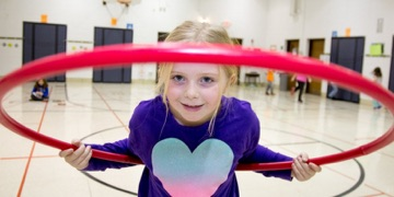 Young girl in a hula-hoop