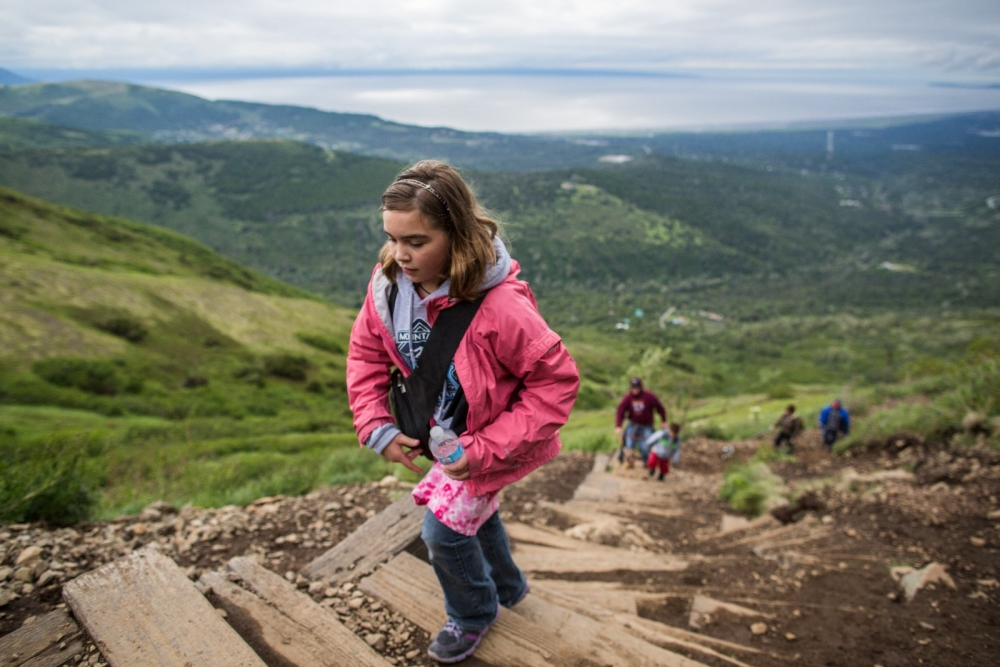 Girl hiking up mountain