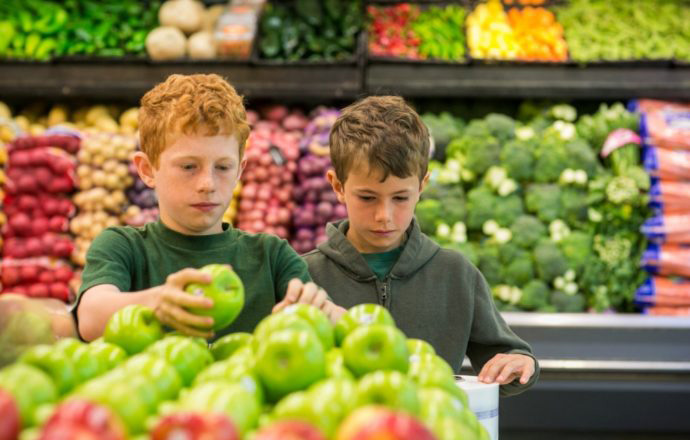 Two boys shopping for produce