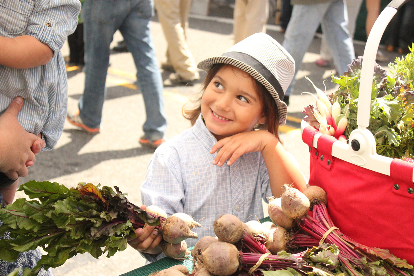 Young kid picking produce