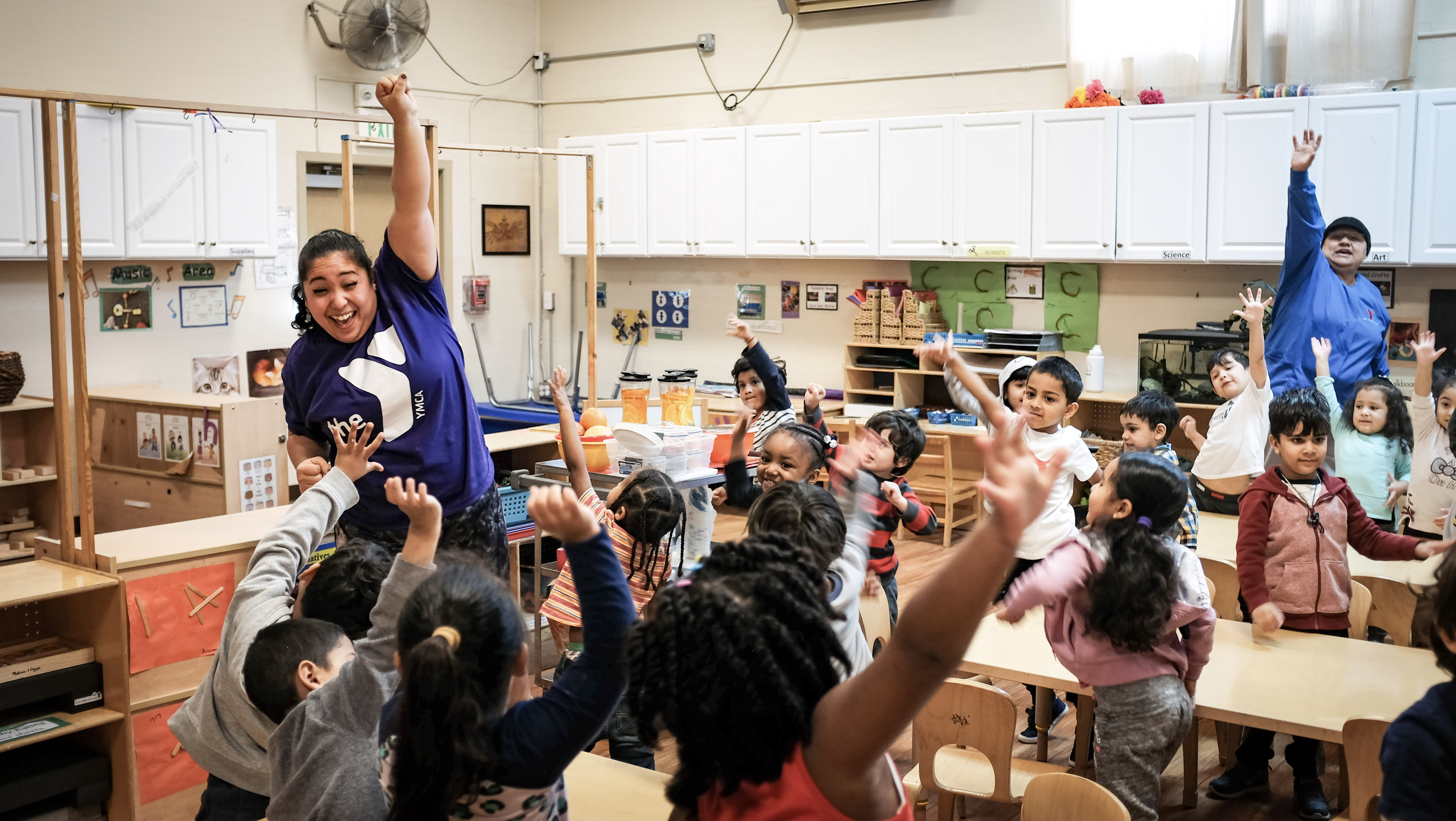 YMCA staff member engages preschoolers in physical activity