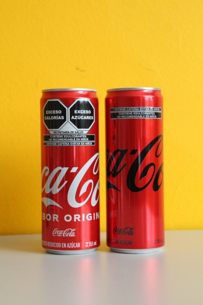A photo showing health warning labels on a can of soda